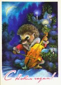 Hedgehog plays the Cello under the snow-covered spruce — Stock Photo