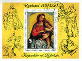 """LIBIA - CIRCA 1983: A stamp printed in Libia shows painting by Raphael """"Virgin and child"""", circa 1983 — Stock Photo"""