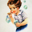 Boy blow bubbles — Stock Photo #11870498