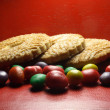 Cookies with lot bright colored candies — Stock Photo