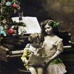 Girl and boy near piano — Stock Photo