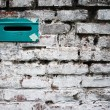 Old brick wall with letterbox slot - Stock Photo