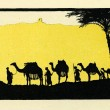Постер, плакат: Merchant caravan of camels in oasis