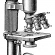 Stock Photo: Microscope with three lenses