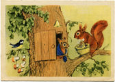 Picture artist N Ushakova shows Family of squirrels near the hou — Stock Photo