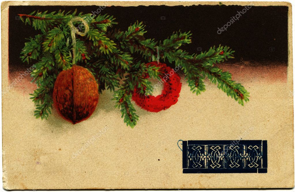 POLAND - CIRCA 1939: Reproduction of postcard shows branch of fur tree with Christmas ball and nut , Poland, 1939 Polish text is sealed by the Soviet authorities, annexed Western Ukraine  Stock Photo #11873792