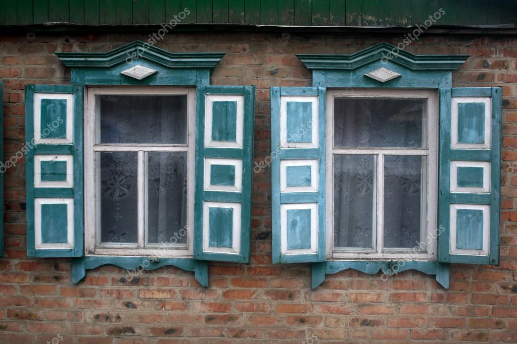 Old window shutters closed with peeling blue paint — Stock Photo #11876586