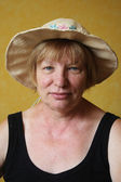Senior woman in the straw hat — Stock Photo