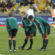 Foto Stock: Referee and his assistans warm up before game