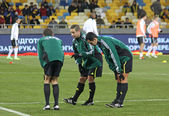 Referee and his assistans warm up before game — Stockfoto