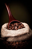 Coffee beans spilling — Stock Photo