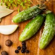 Preparation of small cucumber — Stock Photo