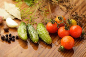 Tomatoes and cucumgers — Stock Photo