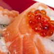 Japanese sushi traditional japanese food.Roll made of salmon, red cavair, roe and cream — Stock Photo #11956792