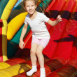 Girl jumping on a trampoline - Stock Photo
