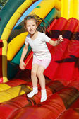 Girl jumping on a trampoline — Stock Photo