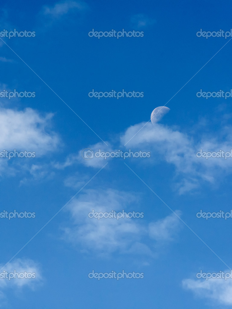 Bright blue morning sky with the half moon and clouds — Photo #11083018