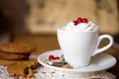 Oat biscuits with coffee and whipped cream — Stock Photo