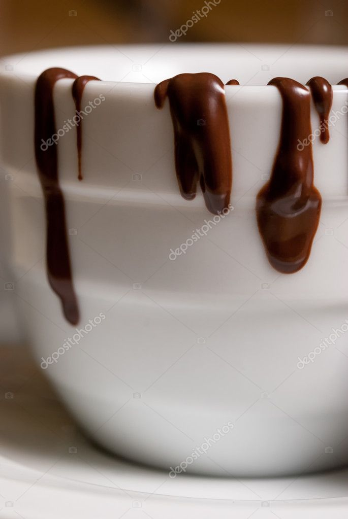 Closeup of White cofee cup with chocolate flowing. Shallow DOF — Stock Photo #11563141