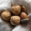 Still-life of three acorns and walnuts — ストック写真
