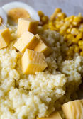 Barley porridge with eggs, cheese closeup — Stock Photo
