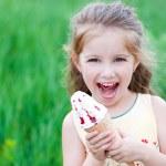 Beautiful little girl eats ice-cream — Stock Photo