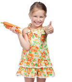 Little girl with the carrot — Stock Photo