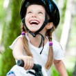 Girl on the bicycle — Stock Photo #11252113