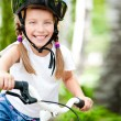 Girl with bicycle — Stock Photo #11347639