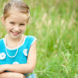 Cute little girl on the meadow — Stock Photo #11436933