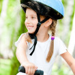 Girl on the bicycle — Stock Photo #11462279