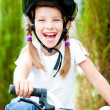 Girl on the bicycle — Stock Photo #11462281