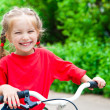 Girl with bicycle — Stock Photo #11496081