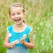 Cute little girl on the meadow — Stock Photo #11556200