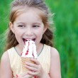 Beautiful little girl eats ice-cream — Stock Photo #11556507