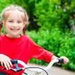 Girl with bicycle — Stock Photo #11556644