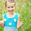 Cute little girl on the meadow — Stock Photo #12173012