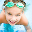 Little girl in swimming pool — Stok fotoğraf
