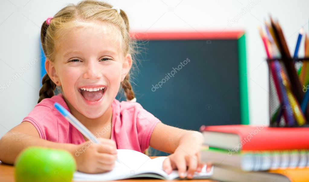 Portrait of smiling girl at workplace with the apple  Stock Photo #12172846