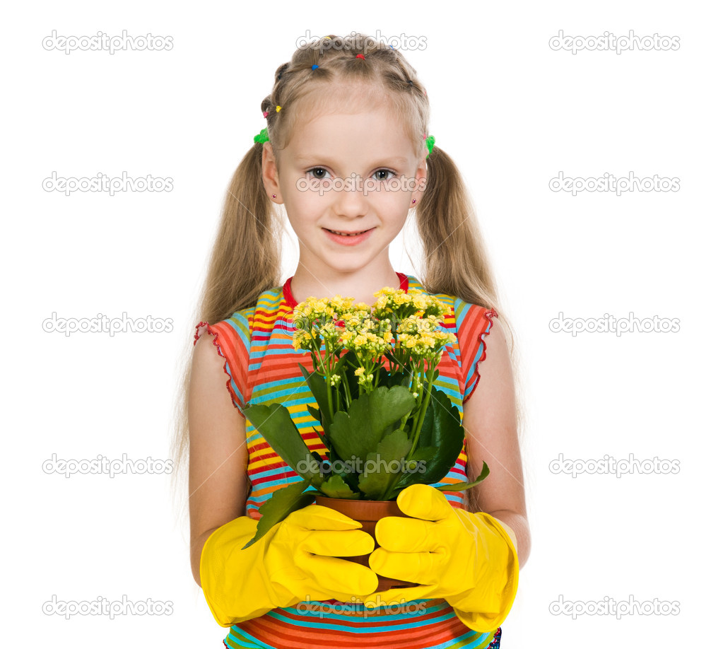 Little girl holding a plant on a white background — Stock Photo #12177347