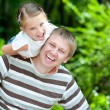 Girl with her dad - Stock Photo