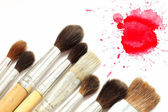 Set of brushes and red blot — Stock Photo