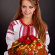 Stock Photo: Young womin ukrainiclothes, with garland and round loaf