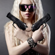 Beautiful sexy girl with guns - Stock Photo
