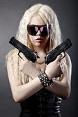 Beautiful sexy girl with guns — Stock Photo