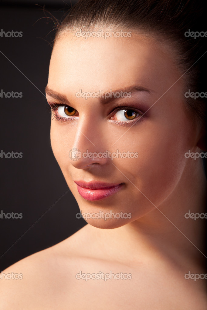 Portrait of a beautiful and young woman isolated on a black background — Stock Photo #10860841