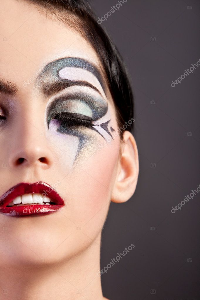 Beautiful fantasy eye face-art close-up portrait of a beautiful girl — Stock Photo #11078523