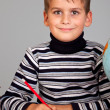 Cute schoolboy is writting — Stock fotografie