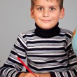 Cute schoolboy is writting — Foto de Stock