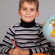 Cute schoolboy is writting - Foto Stock